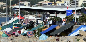 View of the camp set up by migrants, at the Franco-Italian border in Ventimiglia, Italy, Saturday, June 20, 2015. European Union nations failed to bridge differences Tuesday, June 16 over an emergency plan to share the burden of the thousands of refugees crossing the Mediterranean Sea, while on the French-Italian border, police in riot gear forcibly removed dozens of migrants. (AP Photo/Thibault Camus)